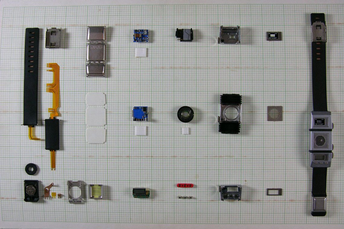 The full complement of components of the watch laid out as assembled